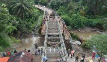 Karena Hujan Lebat, Uji Coba Jembatan Darurat Kayu Tanam Terpaksa Ditunda